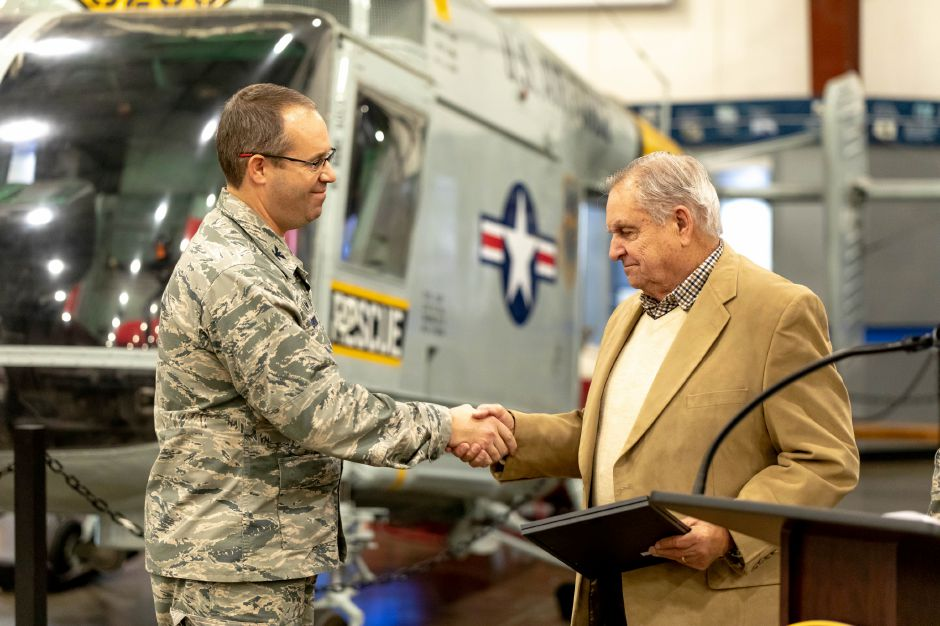 Colonel Stephen Gwinn, left, commander of the 103rd Airlift Wing, presents Korean War veteran Robert Rawlings, of Berlin, with replacement service medals. The ceremony was held at the New England Air Museum in East Granby on Nov. 27, 2018, the medals included the Distinguished Flying Cross and Air Medal. | Devin Leith-Yessian/Berlin Citizen