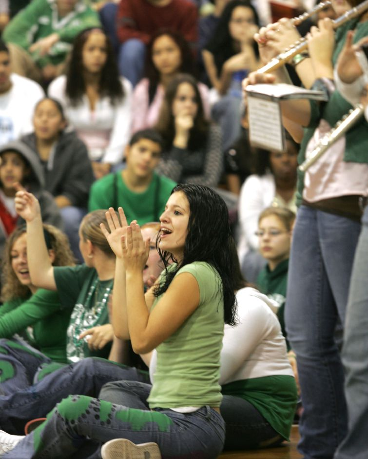 Christy Iavarona claps with her colorguard team during the pep rally at Maloney HS in Meriden Friday afternoon December 1, 2006. Chris Angileri/Record-Journal.