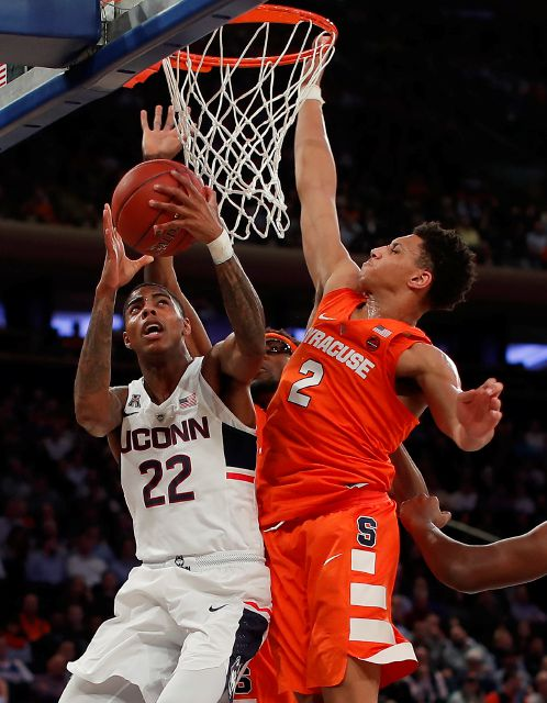 Connecticut guard Terry Larrier (22) puts up a shot against Syracuse forward Matthew Moyer (2) during the first half of an NCAA college basketball game, Tuesday, Dec. 5, 2017, in New York. (AP Photo/Julie Jacobson)