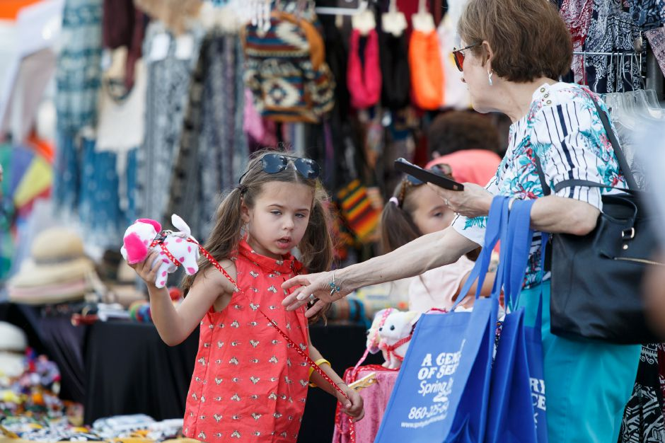 Pearl Gawitt 5 picks out a stuffed animal with grandma Irma Pena of Bristol Friday during the 34th Annual Plainville Balloon Festival at Norton Park in Plainville August 24, 2018 | Justin Weekes / Special to the Record-Journal