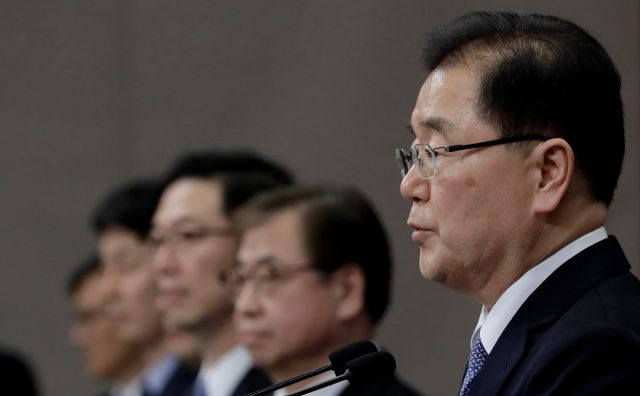 "South Korean delegation head, National Security Director Chung Eui-yong, right, speaks to the media at the presidential Blue House in Seoul, South Korea, Tuesday, March 6, 2018. The delegation led by Chung returned to the South Tuesday after North Korean leader Kim Jong Un held an ""openhearted talk"" with the envoys. (AP Photo/Lee Jin-man)"