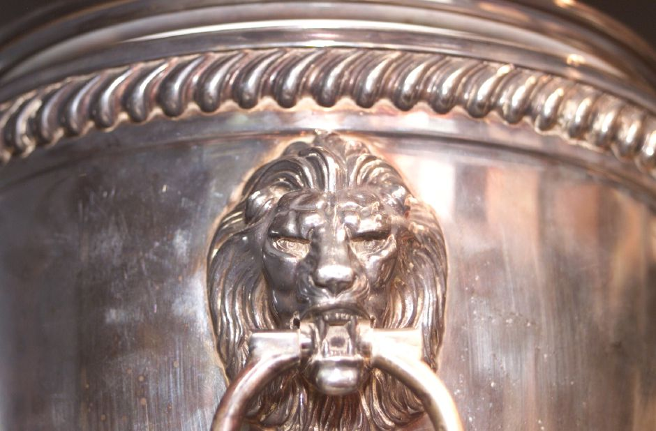 This is a decorative handle on an ice bucket made by International Silver in 1951. It is part of the silver collection of the Wallingford Historic Preservation Trust.