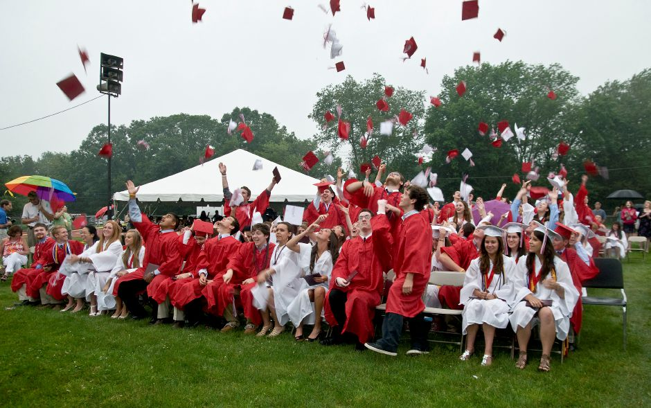 The Cheshire High School Class of 2011 throw their caps into the air after the last name is called during the graduation ceremony at Cheshire High School, June 22, 2011. (Sarah Nathan/Record-Journal)