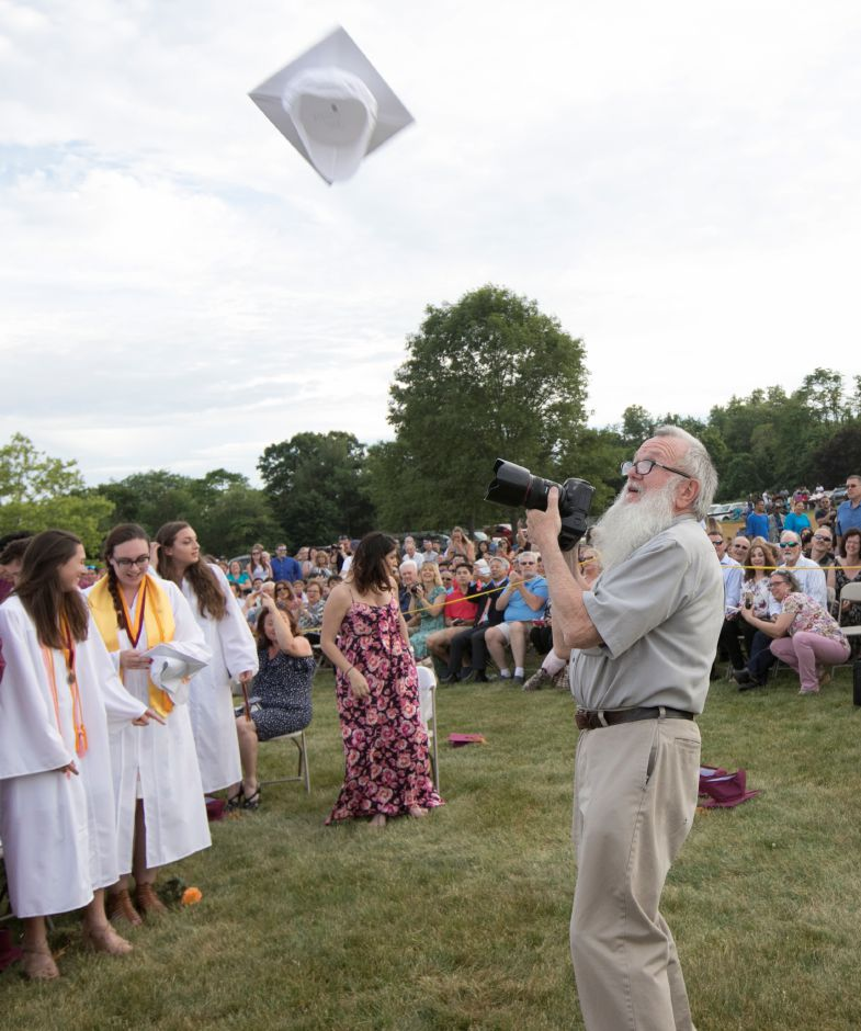 Photographer Ray Ross eyes a cap headed his way while photographing the conclusion of graduation ceremonies at Sheehan High School, Friday, June 22, 2018. Dave Zajac, Record-Journal