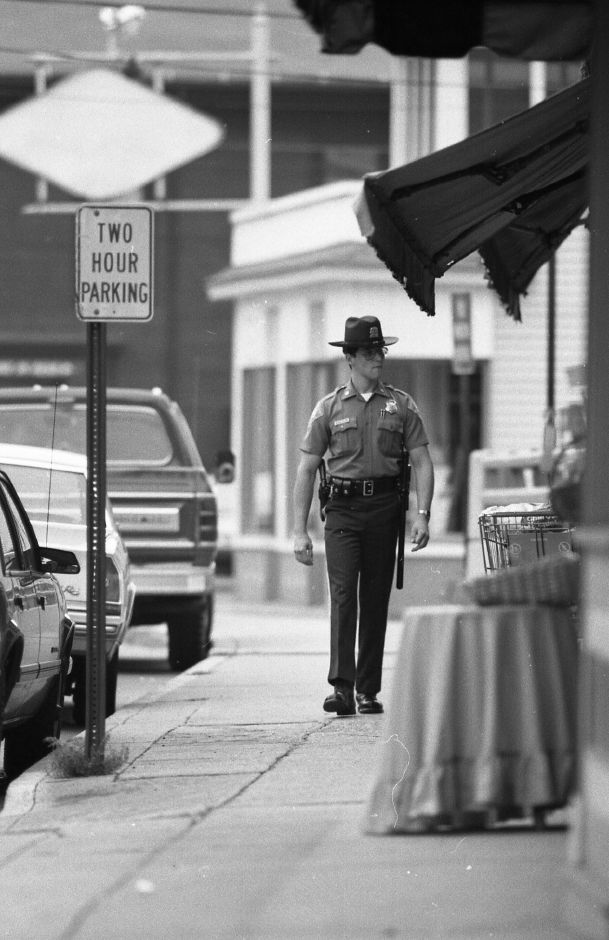 RJ file photo - Supernumerary officer Mark Ferrecchia walks the beat in downtown Plantsville, July 1989.