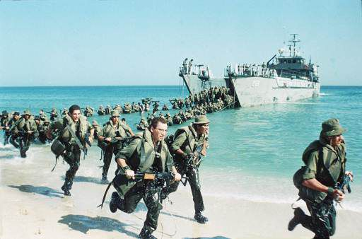 Elite Israeli troops run onto a beach from their landing craft during manoeuvres a few kilometers north of the Gaza Strip on Oct. 31, 1990. The troops were practising landing on the beach at speed. (10/31/1990)(AP Photo/Max Nash)