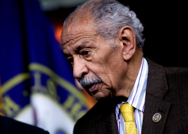 FILE -- In this file photo from Feb. 14, 2017, Rep. John Conyers, D-Mich., attends a news conference on Capitol Hill in Washington. Besieged by allegations of sexual harassment, Conyers resigned from Congress on Tuesday, Dec. 5, 2017, bringing an abrupt end to the civil rights leader