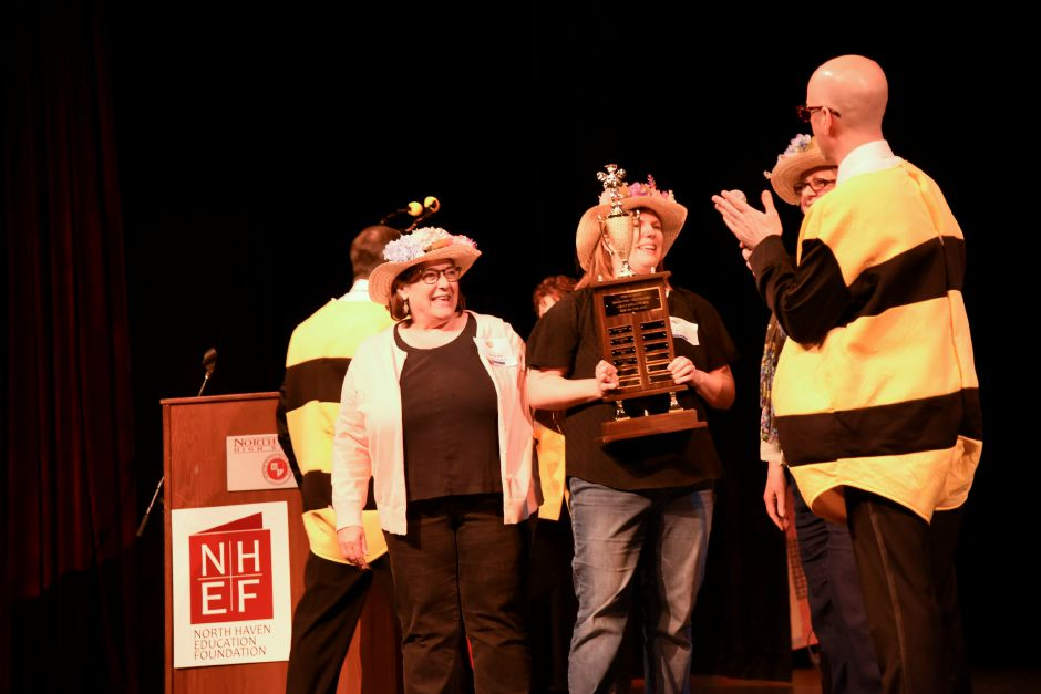 "Team ""Core Bee-ings"" is presented with a trophy after winning the North Haven Education Foundation's fifth annual Adult Spelling Bee on April 25 at the high school. Bailey Wright, Record-Journal"