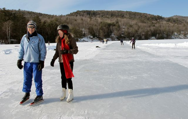 In his Jan. 20, 2018 photo, Stuart McDonald, left, of Center Harbor, N.H., and Judy Stoecklin, of Sanbornton, N.H., skate on Lake Morey in Fairlee, Vt., said to be the longest Nordic ice skating trail in the United States. (AP Photo/Lisa Rathke)