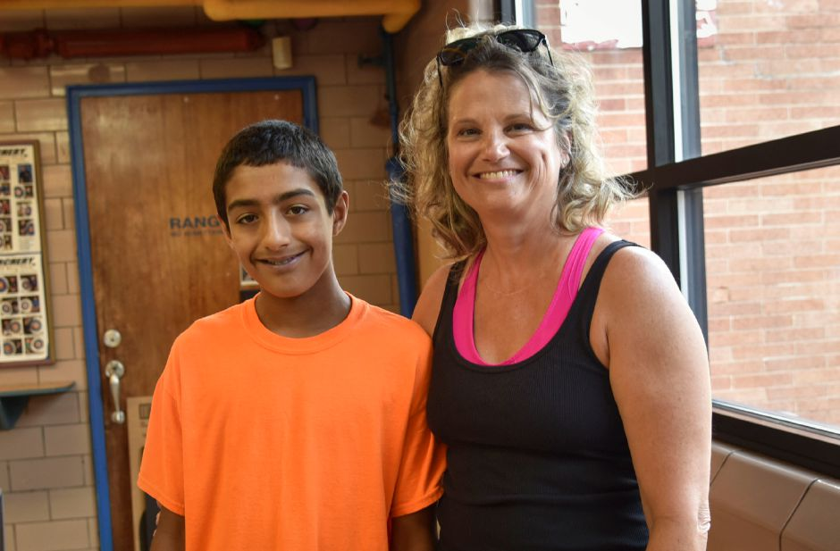 Boys & Girls Club mentor of four years, Debbie Clark, poses with former mentee Xavier Arocho, 14, at the club on Wednesday, Sept. 19. The club is looking to expand its mentorship program. | Bailey Wright, Record-Journal