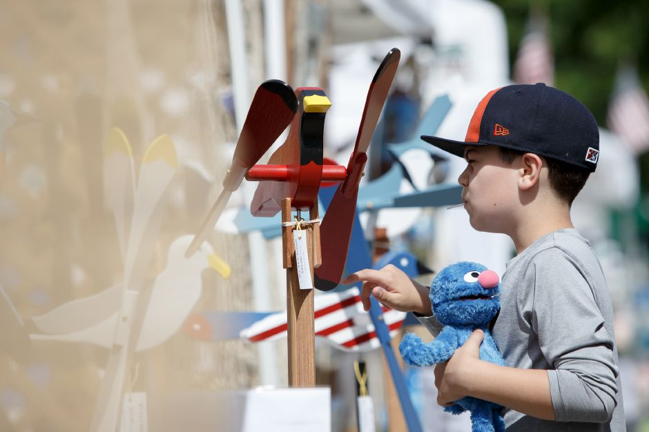 Griffin Kochiss 9 of Cheshire checks out the Wy Fly bird mobiles Saturday during the 81st Annual Cheshire Strawberry Festival and Craft Fair on the Town Green in Cheshire May 31, 2016 | Justin Weekes / Special to the Record-Journal