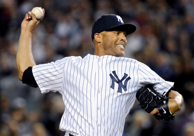 FILE - In this Sept 26, 2013, file photo, New York Yankees pitcher Mariano Rivera delivers the ball to the Tampa Bay Rays during the eighth inning of a baseball game in New York. Rivera will be inducted into the Baseball Hall of Fame on Sunday, July 21, 2019.(AP Photo/Bill Kostroun, File)