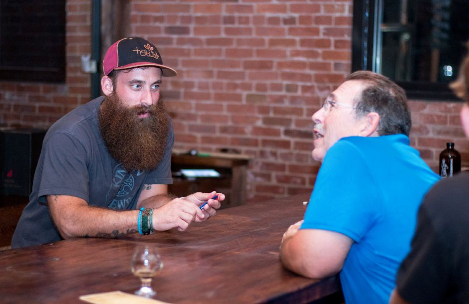 Kinsmen Brewing ranks 10th on TripAdvisor.com's list of things to do in Southington. In this file photo, Chris Carvalho (left) tends bar and speaks to David Busky of Plainville at the CT Small Business Party on August 10, 2017. | Devin Leith-Yessian/Special to the Record-Journal