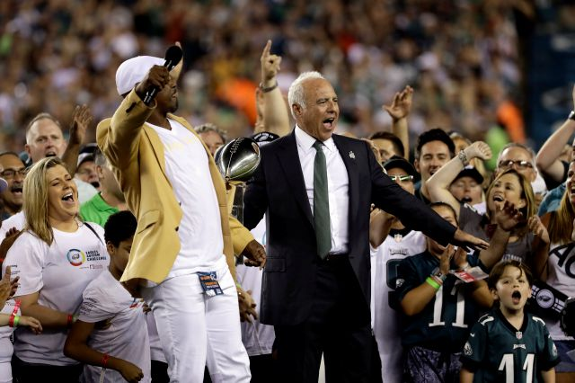 Philadelphia Eagles owner Jeffrey Lurie reacts alongside Brian Dawkins during a ceremony before the team