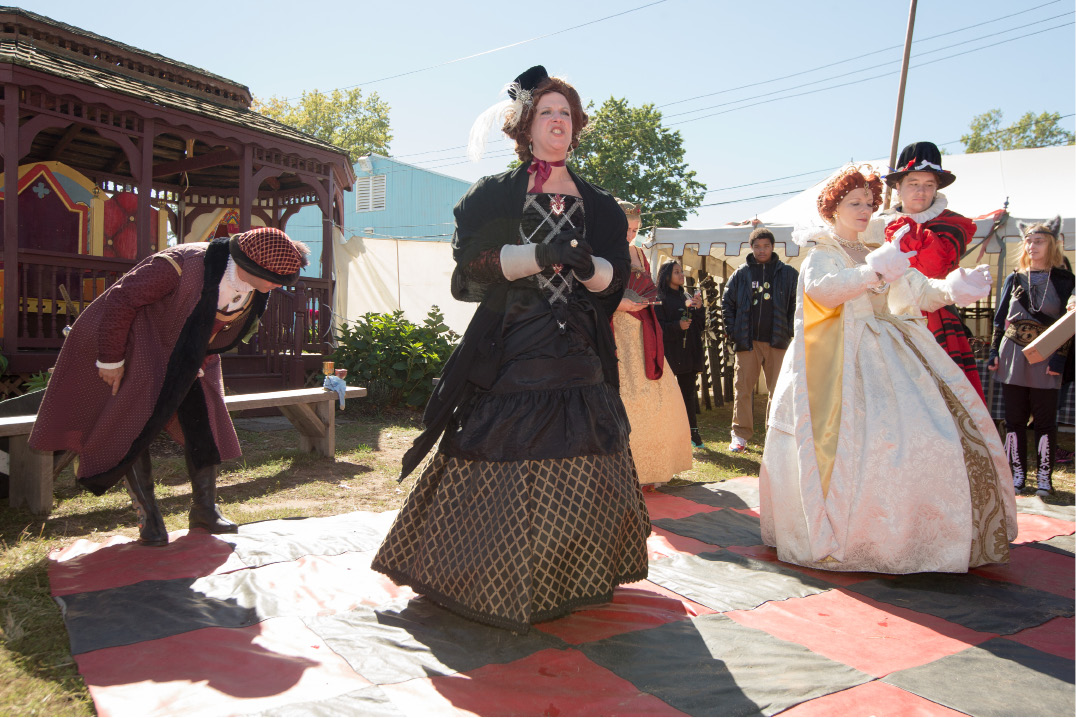 Nicole Morin, of Berlin, as Lady Lettice Knollys announces the Queen at a Human Chess game Monday during the Connecticut Renaissance Faire at the North Haven Fair Grounds. | Justin Weekes /  Record-Journal