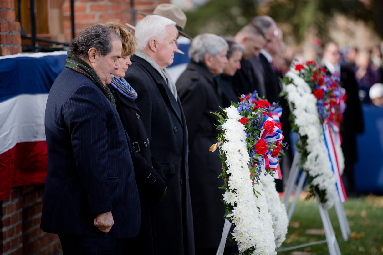 Supreme Court Justice Antonin Scalia, left, Susan Corbett and her husband Pennsylvania Gov. Tom Corbett bow their heads for a moment of silence during a ceremony commemorating the 150th anniversary of the dedication of the Soldiers National Cemetery and President Abraham Lincoln