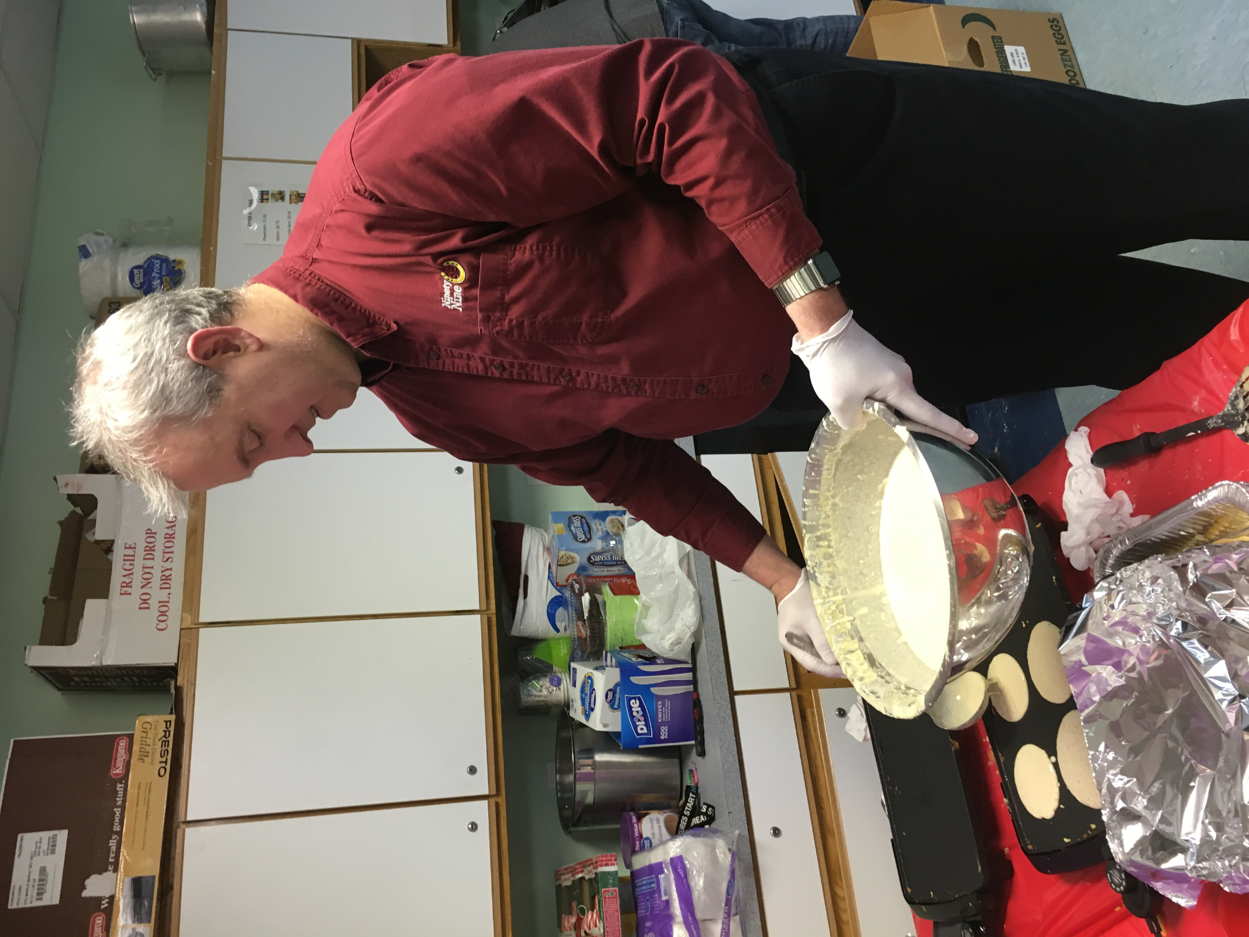 Martin McSheffery, 99 Restaurant assistant manager, makes pancakes at the Ulbrich Boys & Girls Club