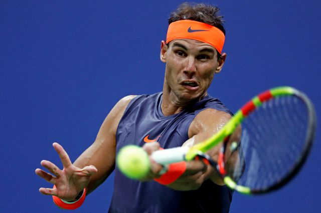 Rafael Nadal, of Spain, returns a shot to Dominic Thiem, of Austria, during the quarterfinals of the U.S. Open tennis tournament Tuesday, Sept. 4, 2018, in New York. (AP Photo/Adam Hunger)