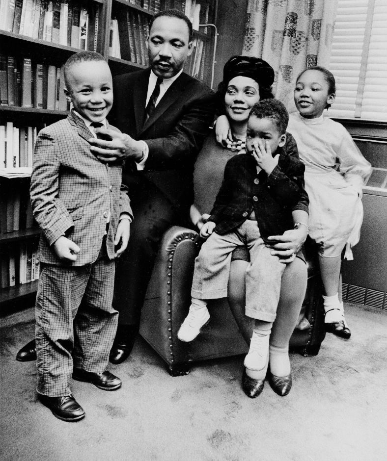 TIME RELEASE FOR 1201 AM APRIL 3*FILE-In this March 17, 1963 file photo, Dr. Martin Luther King Jr. and his wife, Coretta Scott King, sit with three of their four children in their Atlanta, Ga, home. From left are: Martin Luther King III, 5, Dexter Scott, 2, and Yolanda Denise, 7. On April 4, 1968, a movement lost its patriarch when the Rev. Martin Luther King Jr. was killed on a hotel balcony in Memphis. Yolanda, Martin, Dexter and Bernice King lost their father. (AP Photo, File)