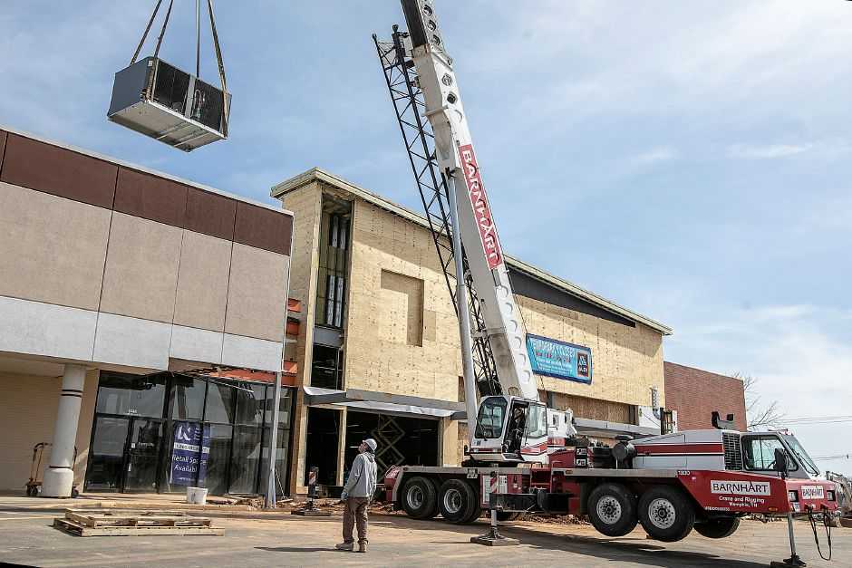 A crane hoists an air conditioning unit onto the roof of Aldi in Wallingford as construction continues there Wednesday, Mar. 27, 2019. Dave Zajac, Record Journal
