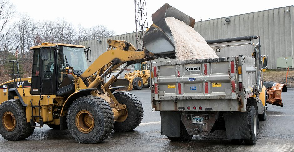 A truck is loaded with salt at the city garage as crews prepare for a winter storm in Meriden, Friday, Feb. 16, 2018. Dave Zajac, Record-Journal