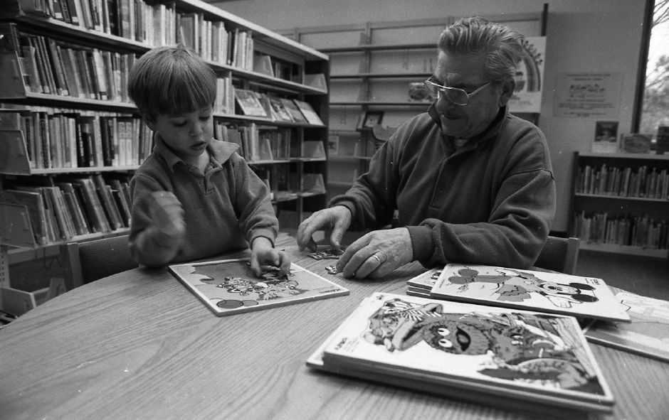 RJ file photo - Eric Blythe, 3, plays with jigsaw puzzles with his grandfather, Michael DiDonato, in the children