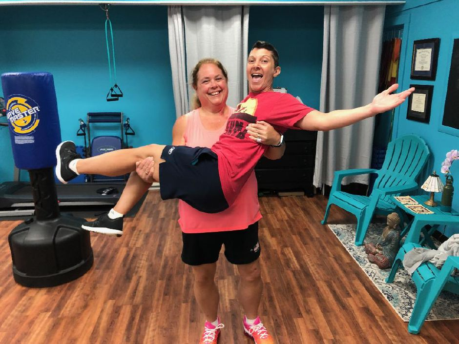 Linda Gilbert holds her personal trainer, Jennifer Nuzzo. Main Street Wellness Studio, Wallingford. |Kristen Dearborn, special to the Record-Journal