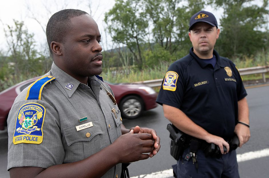 State Trooper Josue Dorelus, left, talks next to Trooper Joshua McElroy about how license plate readers assist with traffic stops on Interstate 91 in Meriden, Fri., Aug. 23, 2019. Dave Zajac, Record-Journal