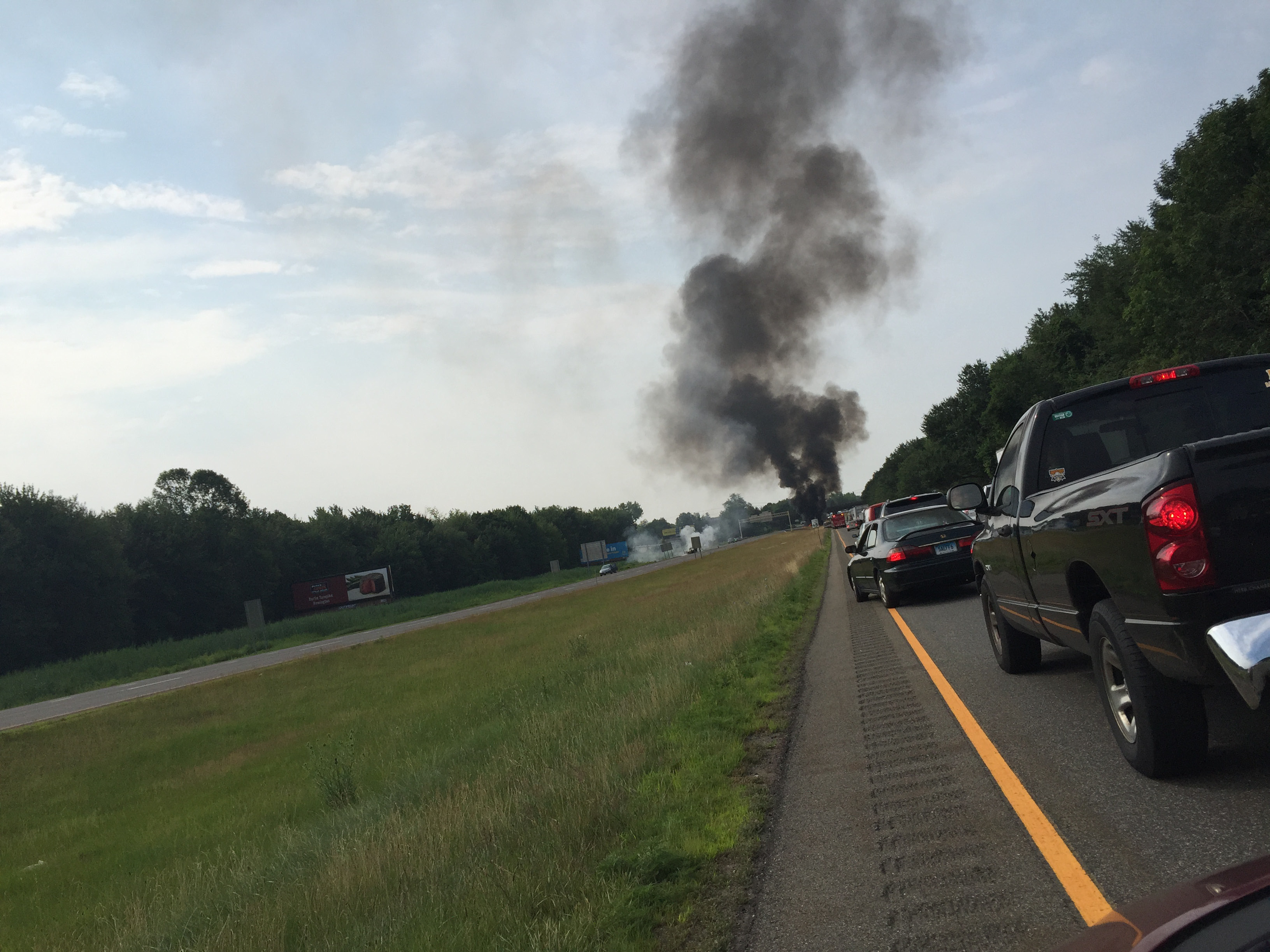 Black smoke can be seen from Interstate 91 South after a crash involving a fuel tanker Monday, July 13, 2015. l Leigh Tauss/Record-Journal