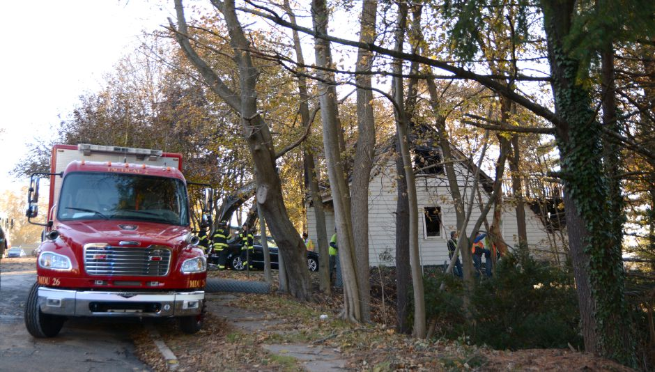 The Meriden fire marshal's office, Meriden police and state police are investigating a house fire on Carpenter Avenue on Thursday, Nov. 23, 2017. | Bryan Lipiner, Record-Journal