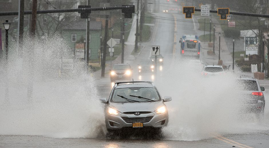 Motorists travel through a flooded section of West Main Street in Cheshire, Monday, April 16, 2018. Dave Zajac, Record-Journal