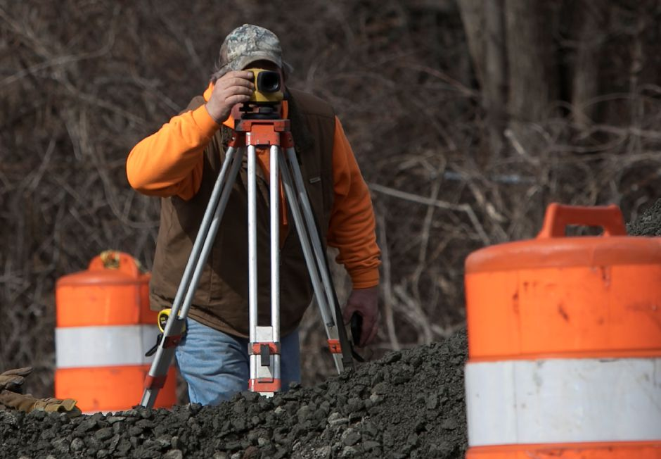 "A worker from LaRosa Construction Co. looks through a scope at the intersection of Pratt Street and Camp Street in Meriden, Monday, February 26, 2018. The 2.7 million project will transform Pratt Street into a boulevard-style ""gateway"" to the downtown. Dave Zajac, Record-Journal"