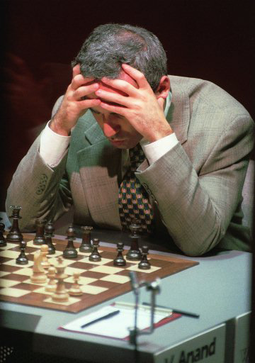 World Champion Garry Kasparov, 32, of Russia, stares at the board  before a move in the seventh game against 25-year-old Indian challenger Vishy Anand at the Professional Chess Association World Championship atop the World Trade Center in New York Thursday, Sept. 21, 1995.  The match ended in a draw. (AP Photo/Bebeto Matthews)