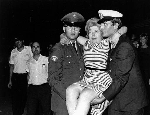Mrs. Helen Vallas of Lynn, Mass, is helped off plane in Athens Aug. 30,1969 after flying there from Damascus, Syria. She broke her ankle escaping from hijacked plane after it was forced to land in Damascus. (AP Photo/pw)