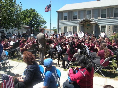 The North Haven High School marching band performs the Star Spangled Banner at the Memorial Day parade. | Ken Liebeskind / The North Haven Citizen