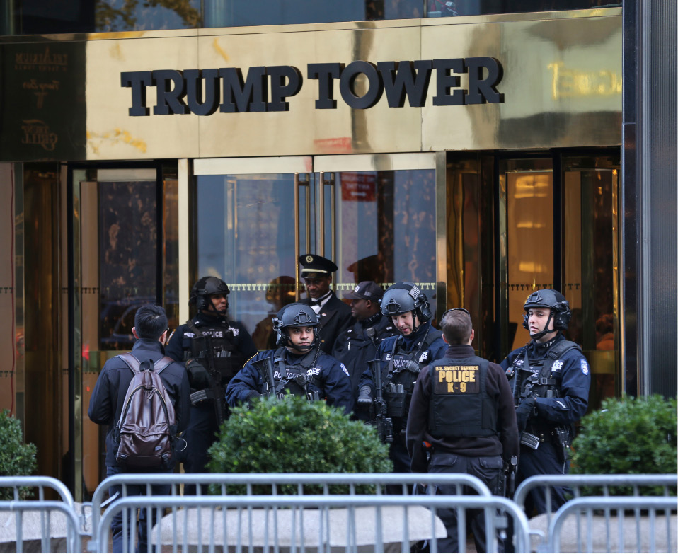 "FILE - In this Nov. 17, 2016 file photo, security personnel stand at the front entrance of Trump Tower in New York. There is no indication that Trump Tower was ""the subject of surveillance"" by the U.S. government before or after the 2016 election, the top two members of the Senate intelligence committee said Thursday, March 16, 2017, directly contradicting President Donald Trump's claims.""Based on the information available to us, we see no indications that Trump Tower was the subject of surveillance by any element of the United States government either before or after Election Day 2016,"" Sens. Richard Burr, R-N.C. and Mark Warner, D-Va., said in a one-sentence joint statement Thursday afternoon. (AP Photo/Seth Wenig, File)"