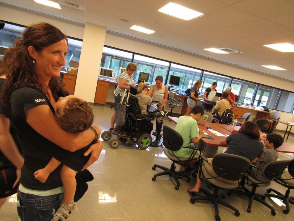 Camp No Limits founder Mary Leighton, an occupational therapist from Maine, holds her 14-month old son, Benjamin, during the teen program at Quinnipiac University's North Haven campus on Wednesday, July 11, 2018. | Lauren Takores, Record-Journal