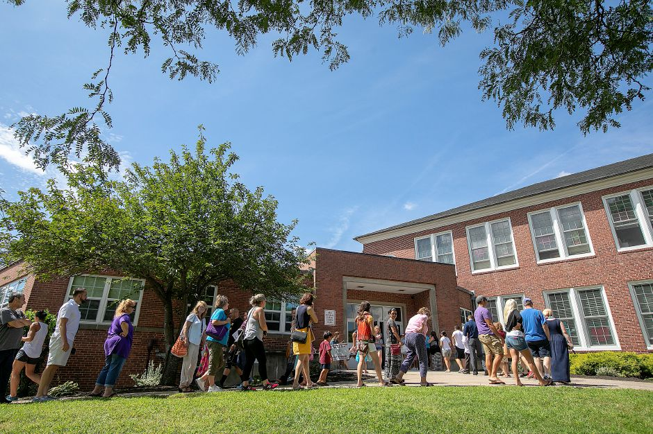 Parents wait to pick up their children during early dismissal on the first day of school at Derynoski Elementary School in Southington, Thursday, August 30, 2018. Dave Zajac, Record-Journal