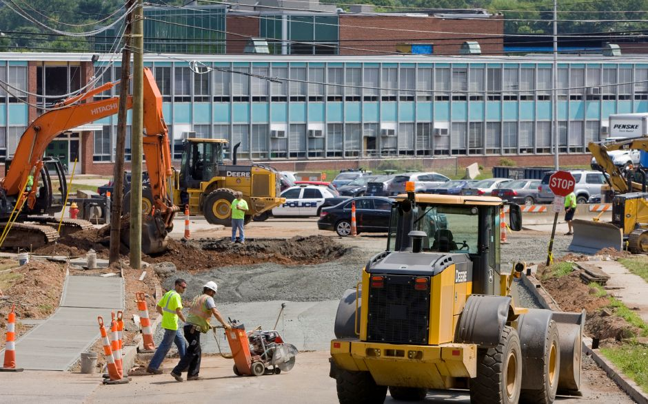 Construction crews work on Liberty and Gravel Streets in front of Maloney High School in Meriden, Monday, August 17, 2015. | Dave Zajac / Record-Journal