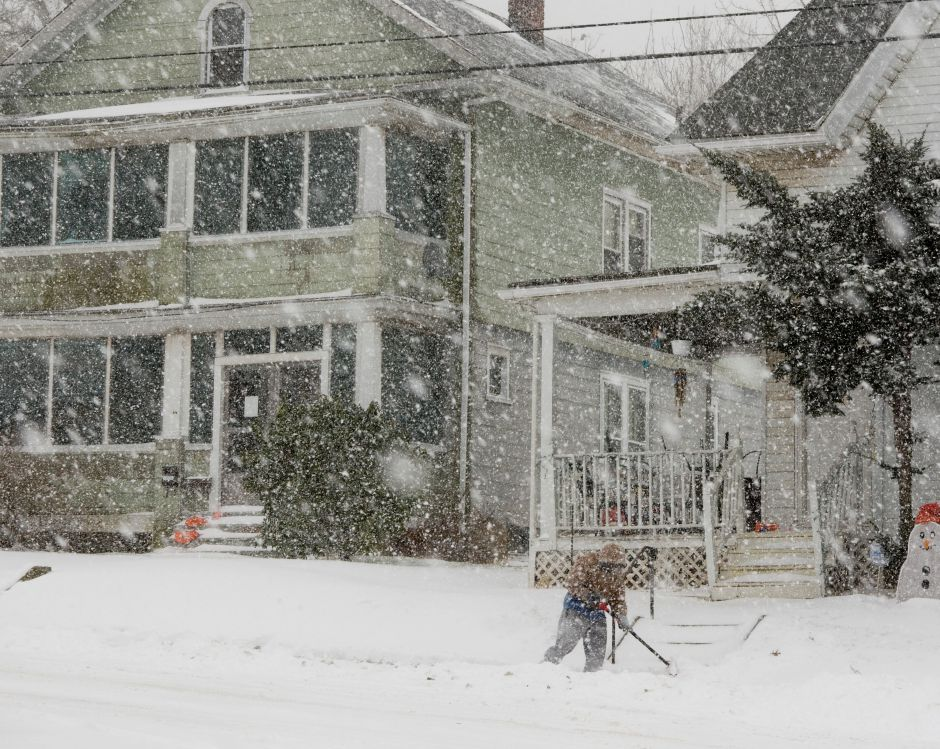 A man shovels the sidewalk on Olive Street in Meriden during a snow storm, Wednesday, Dec. 31, 2008. Visibilty was reduced during the storm because of heavy snow and windy conditions. (Christopher Zajac/Record-Journal)