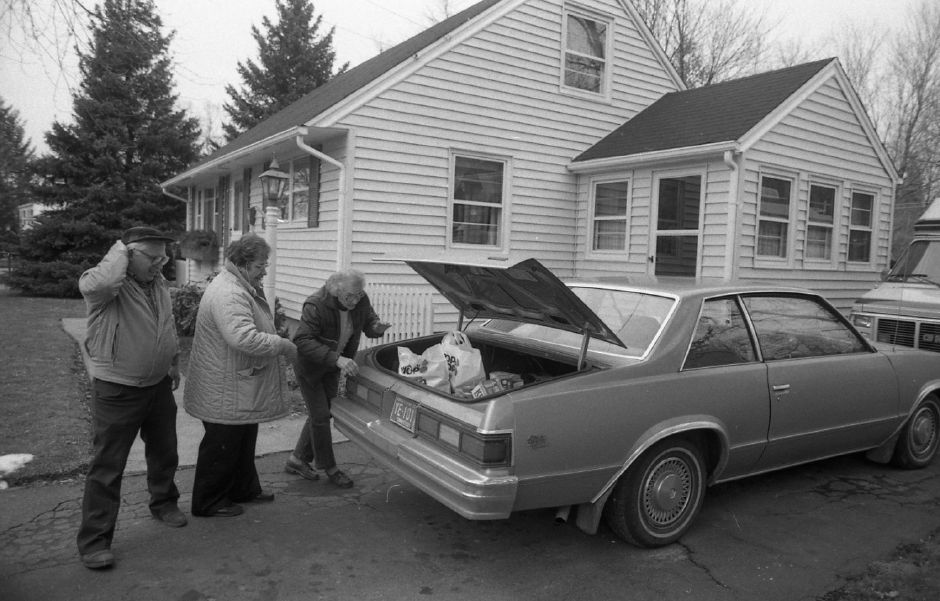 RJ file photo - Beverly Durgan, Denise Poulin and Eleanor Durgan load up a car with food as they take the Food for Friends soup kitchen on the road Jan. 9, 1989.