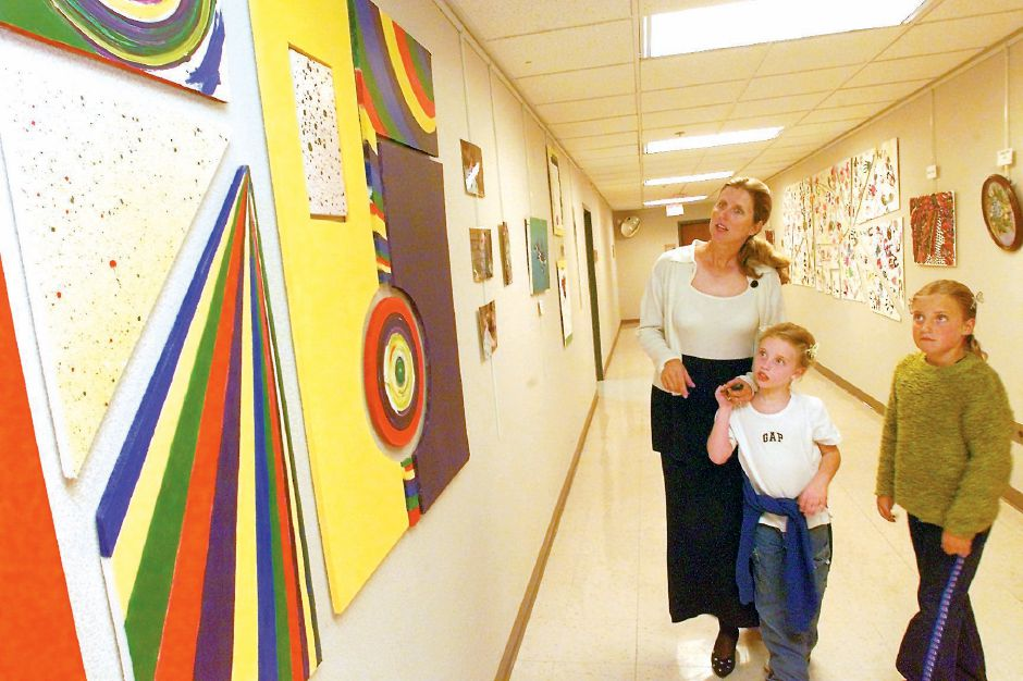RJ file photo - Kathie Welch, a speech/language clinician, along with her daughters MacKenzie, 5, center, and Ryley, 8, right, view artwork done by her client Penter Dean at Gaylord during an exhibit of work by patients April 20, 1999.