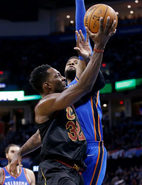 Cleveland Cavaliers forward Jeff Green (32) is fouled by Oklahoma City Thunder forward Paul George during the first half of an NBA basketball game in Oklahoma City, Tuesday, Feb. 13, 2018. (AP Photo/Sue Ogrocki)