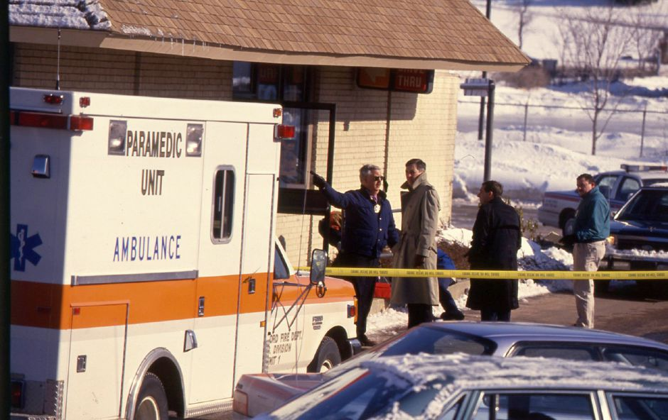RJ file photo - Police confer outside the Burger King on North Colony Road in Wallingford Jan. 19, 1994 after Karen DeMatteo of Hamden was shot to death.