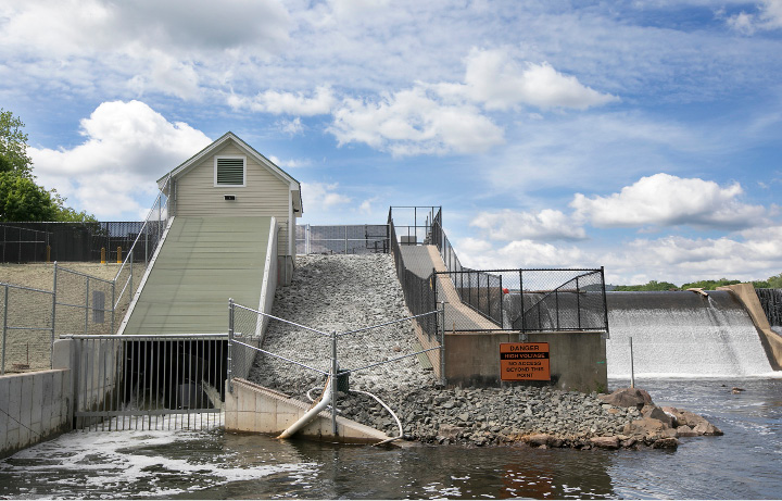 The Archimedes Screw generator, left, at Hanover Pond Dam in Meriden, Wednesday, May 24, 2017. Meriden is the first city in the nation to install the technology of ancient Greek scientist Archimedes.    | Dave Zajac, Record-Journal