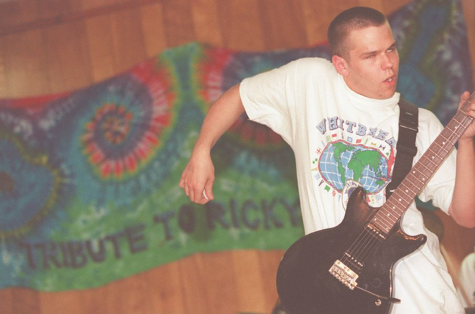 RJ file photo - Peter Allison, 19, of Wallingford works himself into a guitar frenzy as he jams with other members of Live Bait during Music Marathon tribute to Richard Lee May 3, 1998.