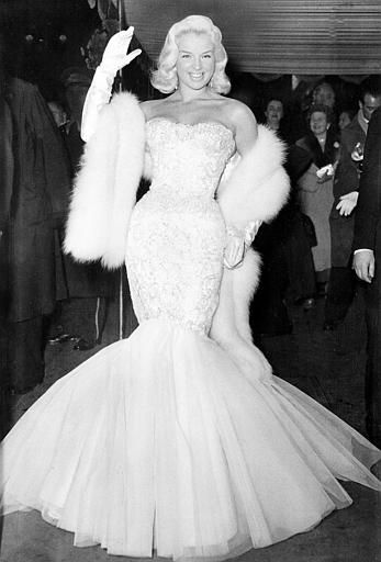"British actress Diana Dors arrives for the royal film screening of ""To Catch A Thief"" at the Odeon, Leicester Square, London, England, Oct. 31, 1955.  (AP Photo)"