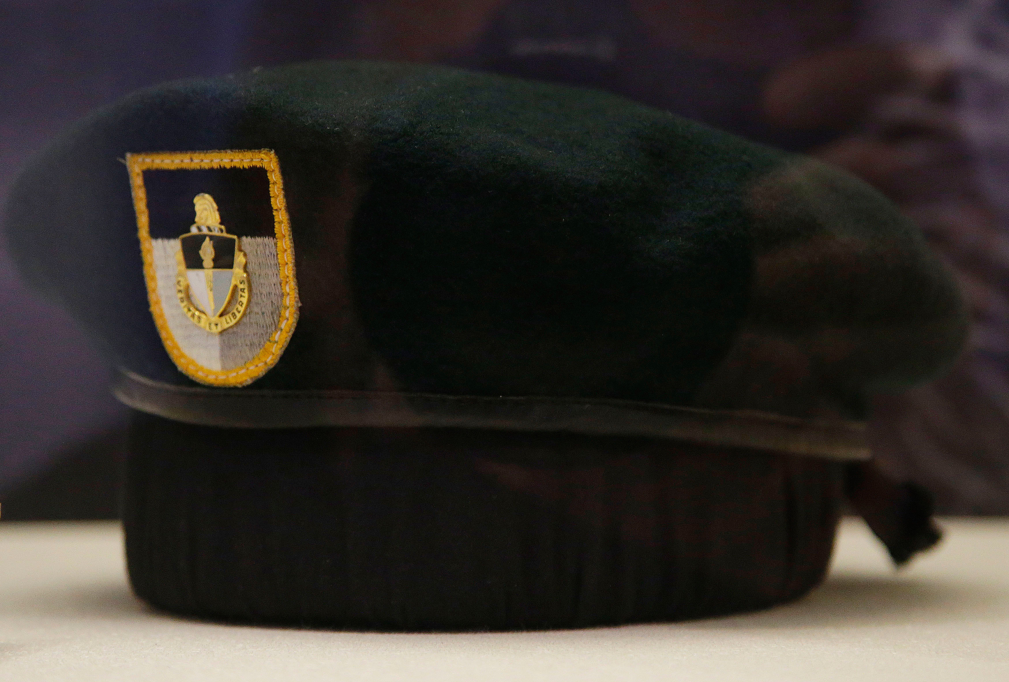 "A small new exhibit at the John F. Kennedy Library and Museum marking the 50th anniversary of the assignation of the 35th President of the United States includes never-before-displayed artifacts from his three-day state funeral, such as this ""green beret"" laid at the grave of the fallen president by Sgt. Maj. Francis Ruddy, a Special Forces Soldier, three days after Kennedy"