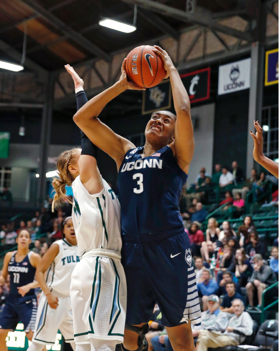 aa1a4821d93d Connecticut forward Morgan Tuck (3) goes to the basket against Tulane guard  Leslie Vorpahl