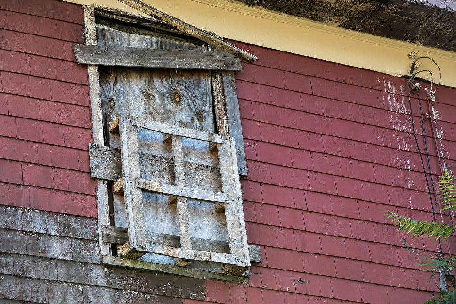 A wood pallet covers a window frame on a partially collapsed blighted property at 11 Colony Pl in Meriden, Wednesday, August 30, 2017. | Dave Zajac, Record-Journal